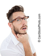 Nerdy businessman looking at camera on white background