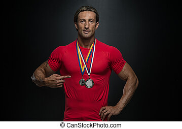 Middle Age Athlete Competitor Showing His Winning Medal