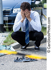 Man crying at accident scene - Elegant man crying at...