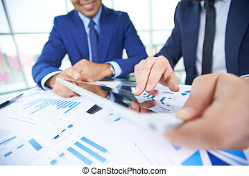 Networking - Businessman hand pointing at document in...
