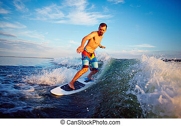 Man surfboarding - Young man surfboarding on summer vacation