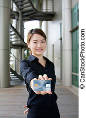 Asian business woman with credit card