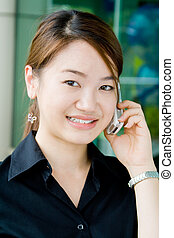 Asian business woman with phone