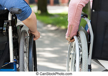Couple of friends on a wheelchair, horizontal