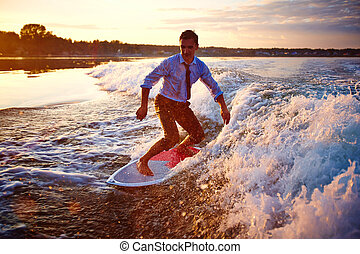 Wave ride - Attractive sportsman surfboarding at summer...