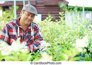 Mature gardener - Mature male gardener looking at camera...
