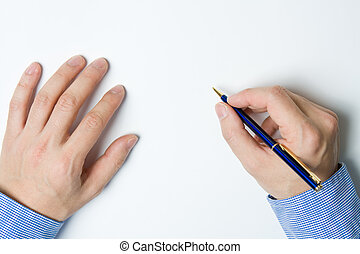 Person writing on paper - Person writing a message on a...