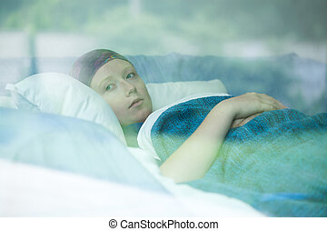 Young woman suffering from cancer - Young woman in bed...