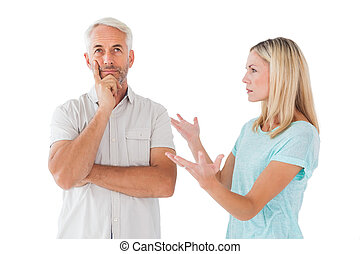 Unhappy couple having an argument with man not listening on...