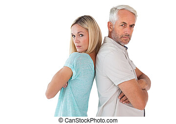 Unhappy couple not speaking to each other on white...