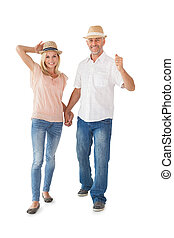 Happy couple walking holding hands on white background