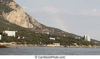 Rainbow over sea shore - Beautiful rainbow over sea shore