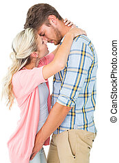 Attractive young couple about to kiss on white background