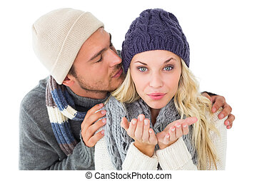 Attractive couple in winter fashion on white background