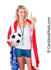 Pretty blonde football fan wearing usa flag showing thumbs...