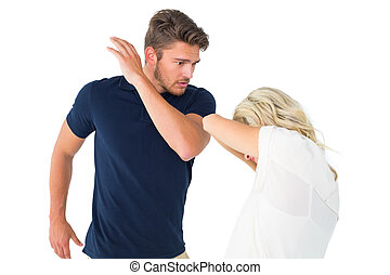 Angry man about to hit his girlfriend on white background