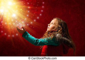 Young girl touching stars. - Conceptual portrait of cute...