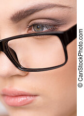 Beautiful young woman wearing glasses close-up. face of beautiful businesswoman working at office