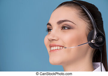 Close up on female's face with microphone. young brunette...