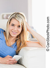 Beautiful woman text messaging - Relaxed beautiful young...