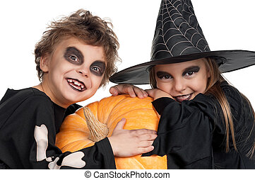 Child in halloween costume - Boy and girl wearing halloween...