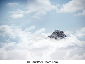 Mountain peak through the clouds - Digitally generated...
