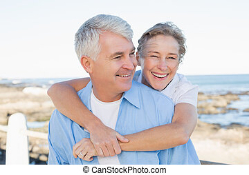 Casual couple having fun by the sea on a sunny day