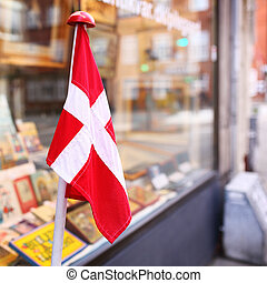 Store facade with a danish flag - Danish flag. Store....
