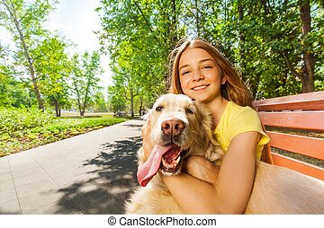 Close portrait of the teenage girl with happy dog - Portrait...