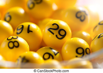 Background of yellow balls with bingo numbers used to...