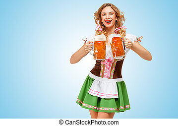 Serving with laugh - Young sexy Oktoberfest woman wearing a...