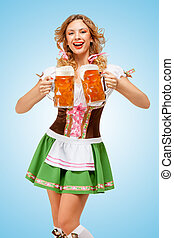 Serving with laugh. - Young sexy Oktoberfest woman wearing a...