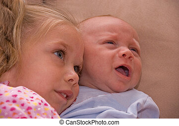 Comforting Crying Baby Brother - This cute shot of siblings...