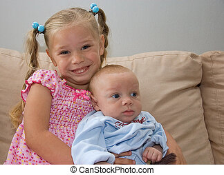 Sister and Baby Brother - These siblings are sitting...