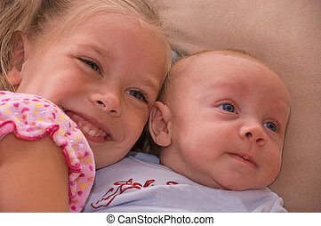 Sibling Love - This baby brother and 4 year old sister are...
