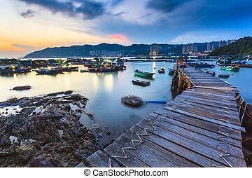Sunset at fishing village wooden bridge
