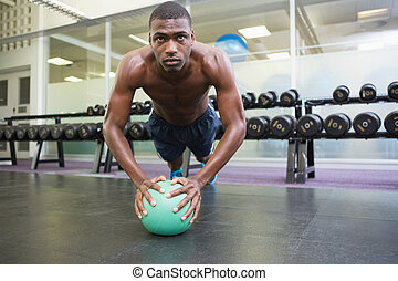 Determined man doing push ups - Determined shirtless...