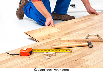 Man laying laminate flooring - carpenter worker installing...