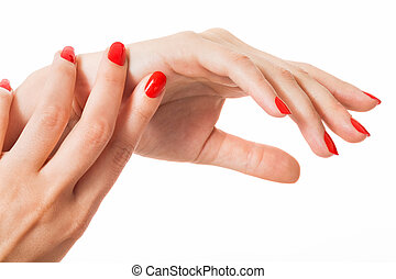 Woman with beautiful manicured red fingernails gracefully...