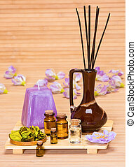 Aromatherapy accessories: floral petals, bottles filled with...