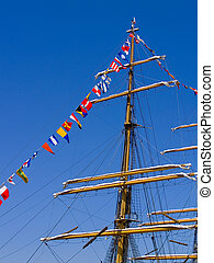 Tall Ship Mast - Nautical flags decorate the mast of a tall...