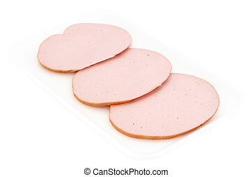 Slices of wurst in a plastic white container isolated on...