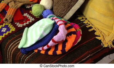 granddaughter granmother - Many knitted colorful caps and...