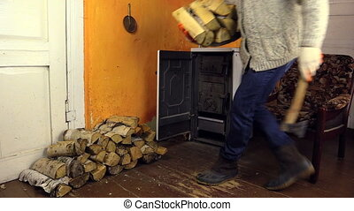 villager axe firewood - Villager man carry armful of...