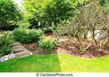 Home garden. Landscape idea for backyard