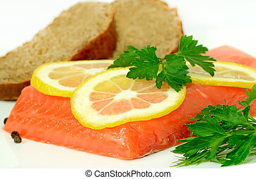 Salmon, lemon slices and parsley