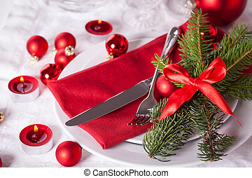 Red themed Christmas place setting with a colorful red...