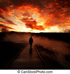 Sunrise Yellowstone Geysers with Man Silhouetted - Sunrise...