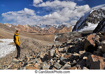 Hiker in Pamir mountains - Young adventurer hiking in Pamir...