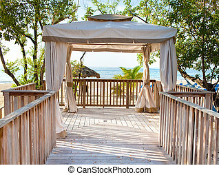 Pavilion in natural style on a beach.